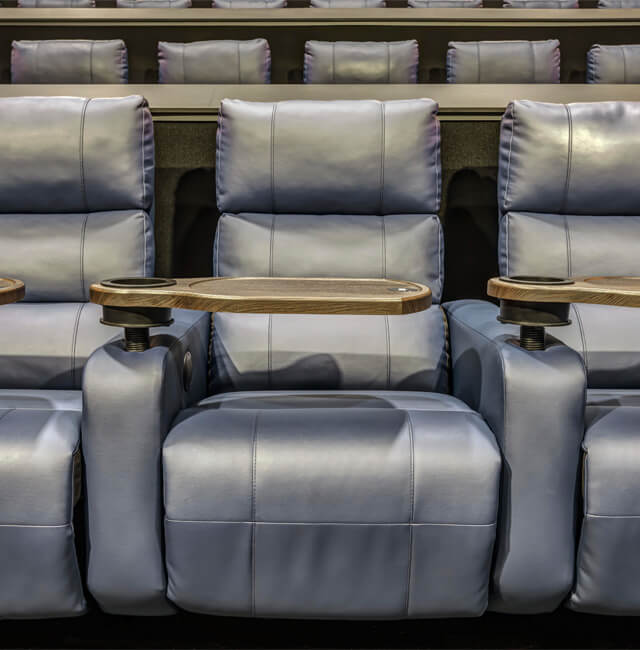 Image of luxury recliner seats with tray tables