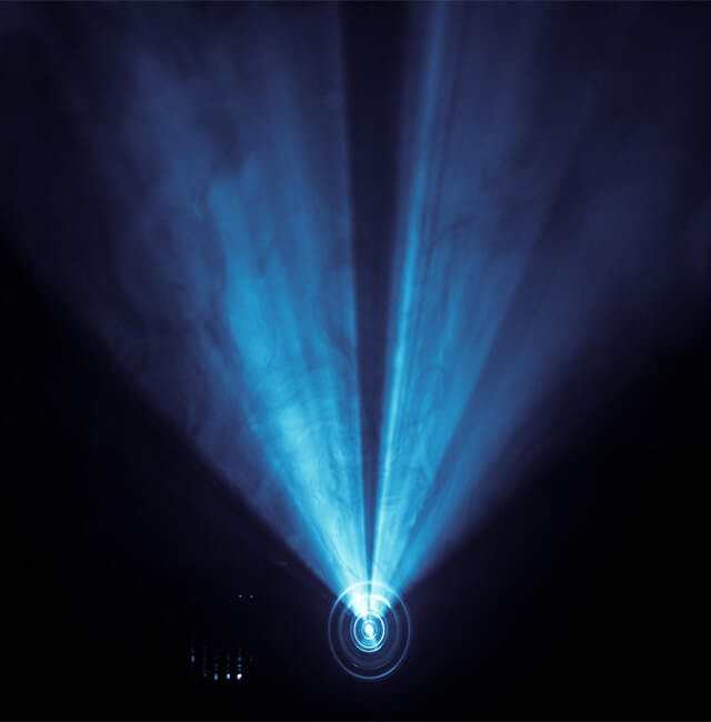 Image of light shining from a projector