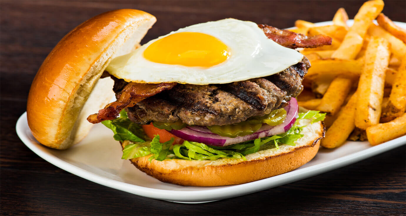 Image of a hamburger topped with a fried egg