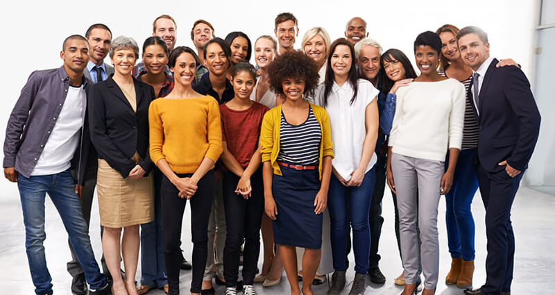 Image of a group of smiling people in business casual attire